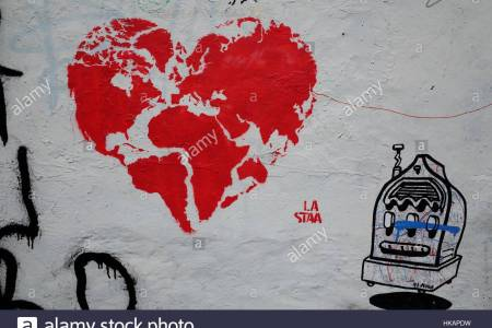 Map graffiti a street art graffiti showing the world map in the shape of a heart hkapdw gumiabroncs Image collections