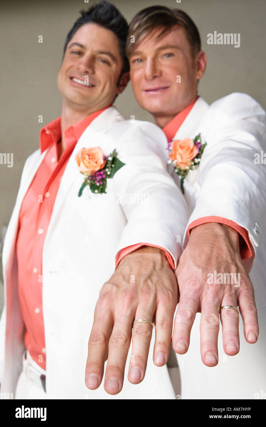 gay wedding rings gay wedding bands Gay couple showing off wedding rings Stock Image