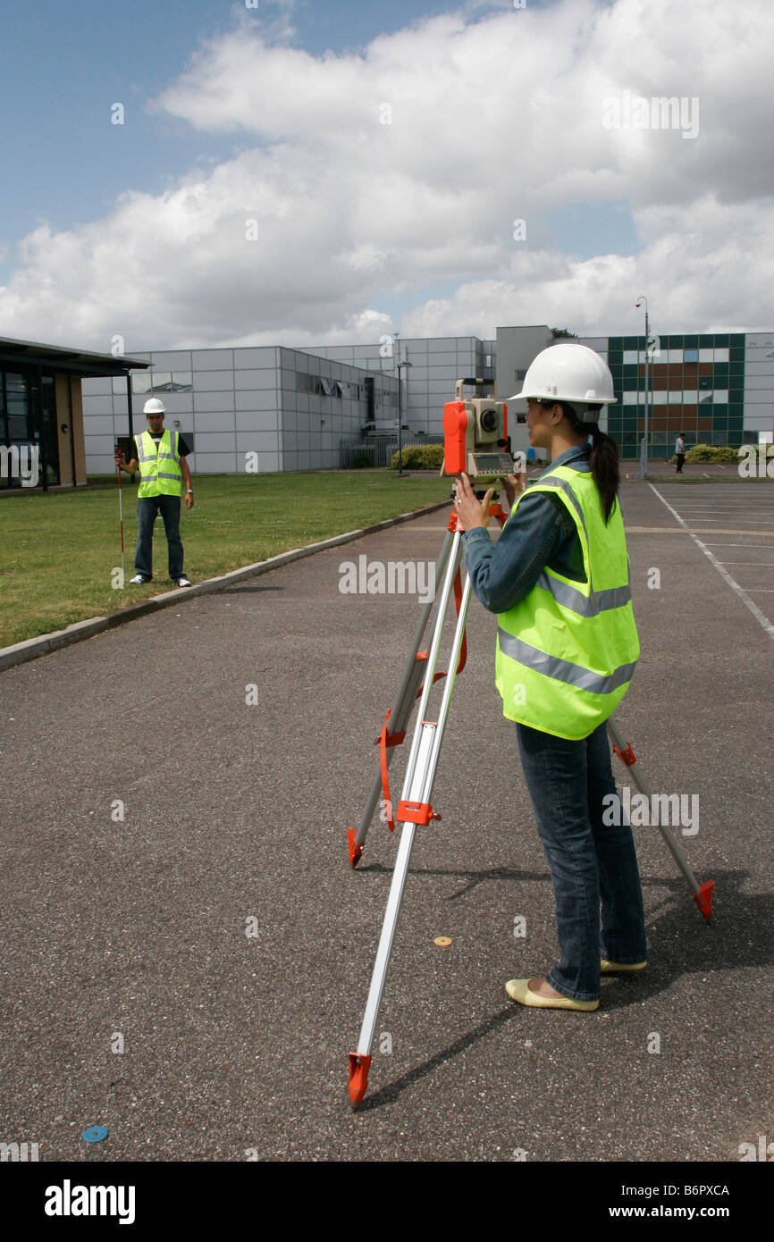 BTEC National Diploma in Construction  Female student surveying     BTEC National Diploma in Construction  Female student surveying wearing  high visibility vest   hard hat London GB