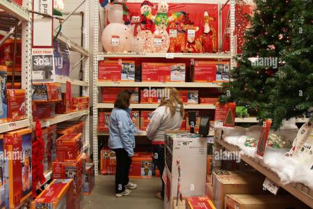 shoppers looking for christmas decorations at a home de store in b71en0