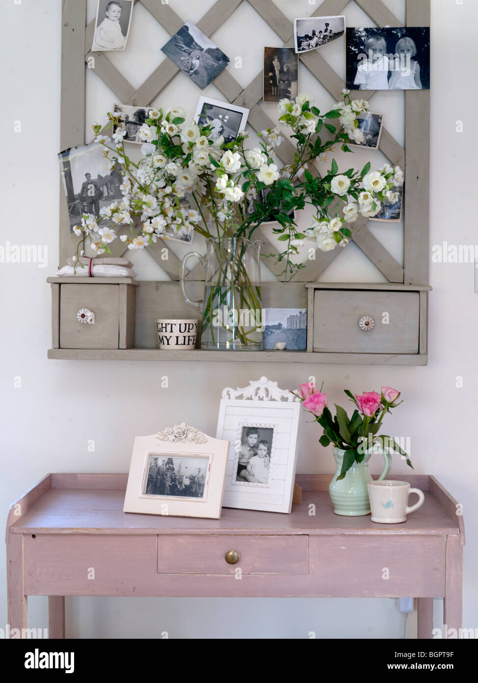 stock photo country kitchen side table with photo frames and flowers kitchen side table Stock Photo country kitchen side table with photo frames and flowers