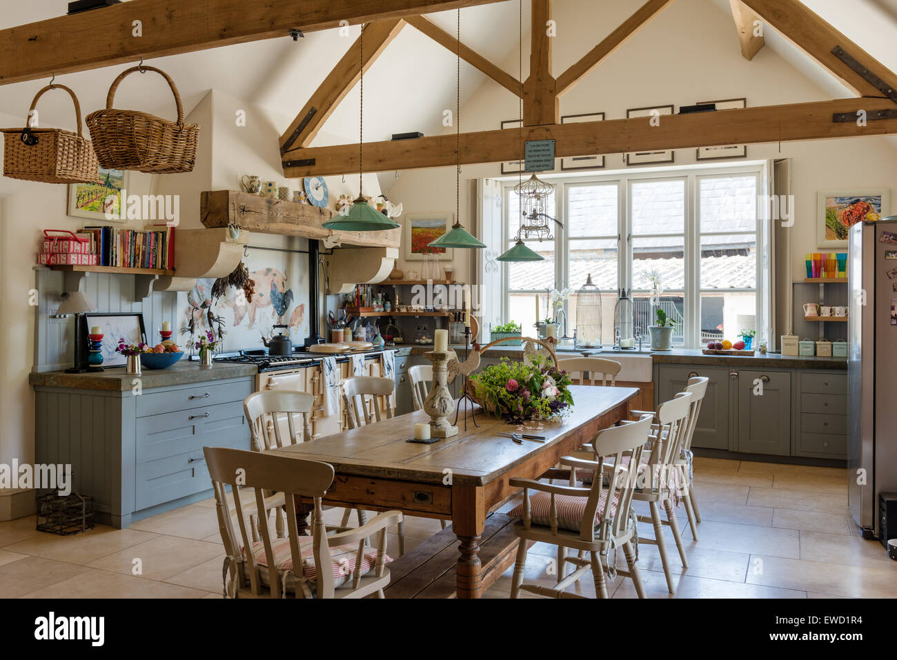 vintage farmhouse table in rustic kitchen with green pendant lights EWD1R4