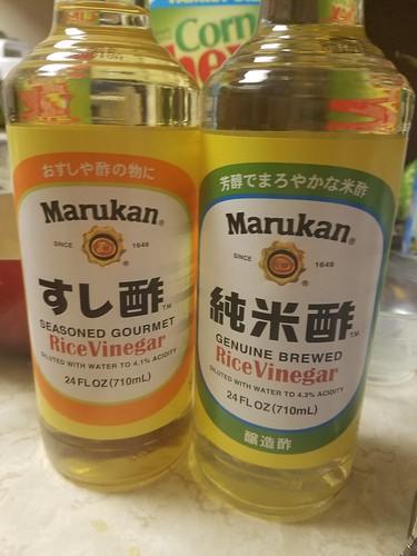 Bottles of Marukan Seasoned Rice Vinegar on the left, and Marukan (Plain) Rice Vinegar on the right