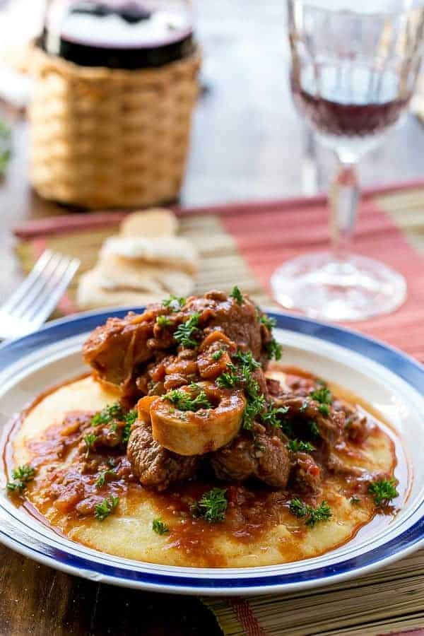 ... Bucco in Red Wine Salsa with Soft Polenta | http://cafedelites.com