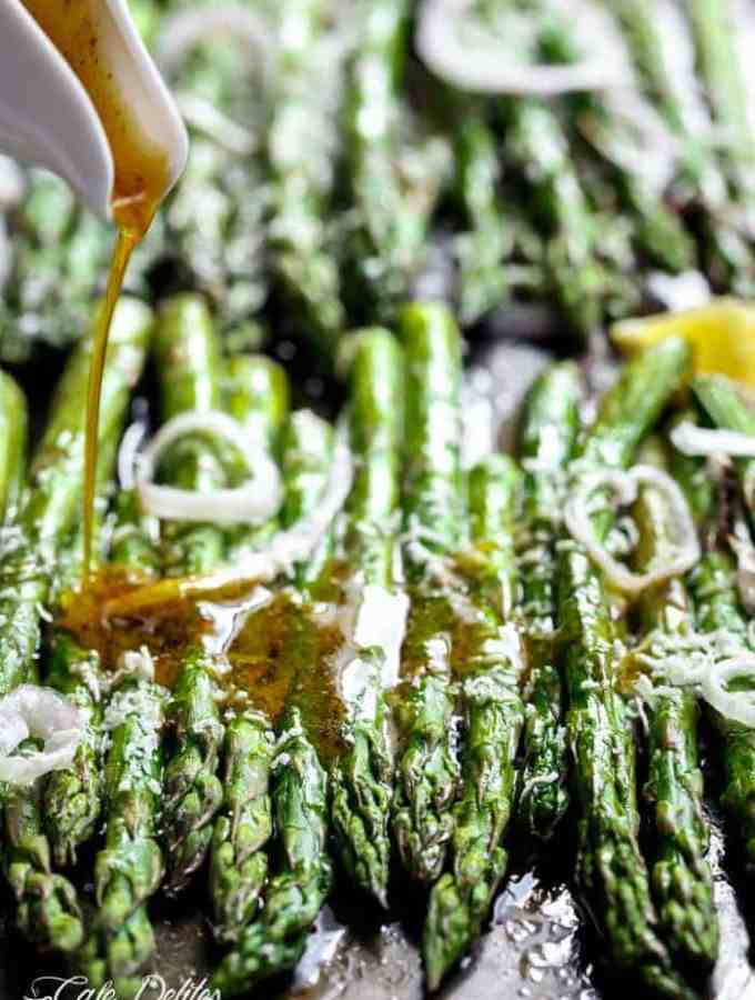 Garlic Browned Butter Baked Asparagus with Parmesan Cheese would have to be the perfect accompaniment or side dish! A delicious way to eat greens! | http://cafedelites.com