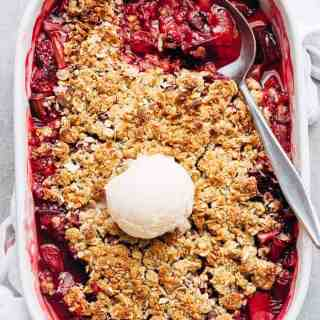 Strawberry Rhubarb Crisp is quick and easy to make desserts at only 263 calories per serve! Strawberries mix with rhubarb underneath an oatmeal cookie-like crisp!   http://cafedelites.com