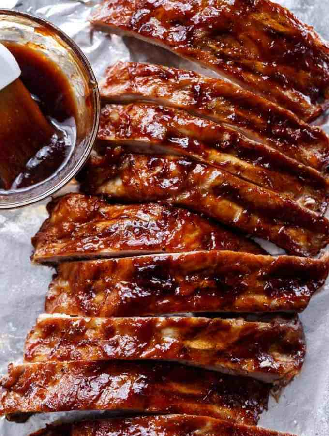 Easy Slow Cooker Barbecue Spare Ribs are melt-in-your-mouth incredible! Let your slow cooker do all the work and come home to sticky, fall apart ribs! | http://cafedelites.com