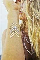 Arrow metallic tattoo