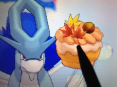 I transferred my shiny event Suicune!  Here he is eyeing a Supremem Fall PokePuff.