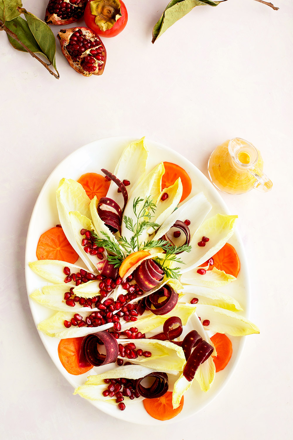Endive Pomegranate Salad is a festive gluten free salad with a wonderful persimmon chevre vinaigrette.