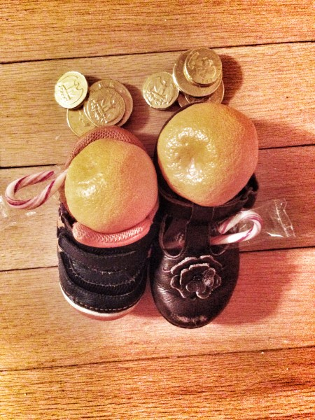 someday the oranges will actually fit in their shoes. sniff.