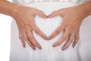 pregnant-woman-heart-shape-symbol-belly