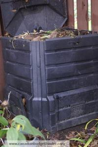 Compost bin with organic waste in the top