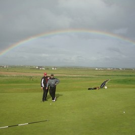 The rainbow connection: Golf designer Yannick Pilon and some hack look for the pot of gold at Doonbeg during our last round in Ireland.