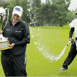 Champagne Supernova: CN Canadian Women's winner Brittany Lincicome gets dousted after winning the tournament in nasty conditions yesterday.
