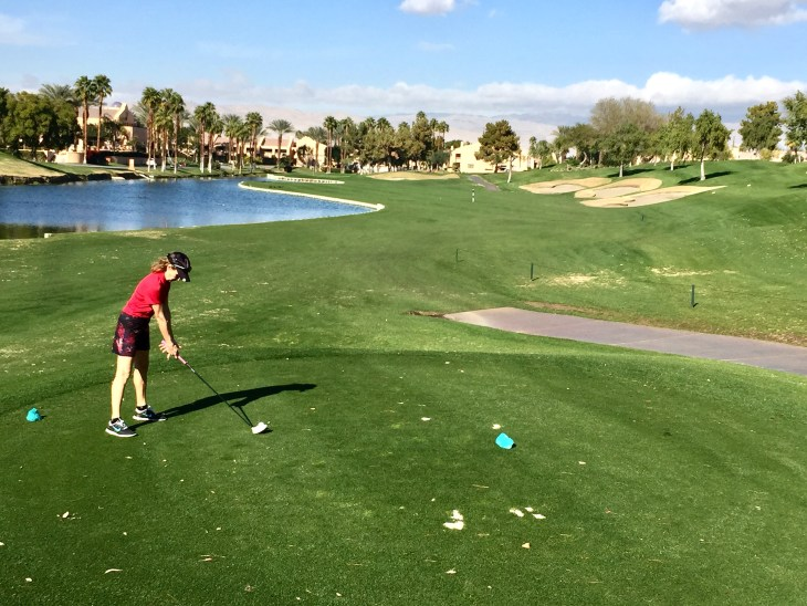 Myra tees off on a great finishing hole, the Par 4 18th