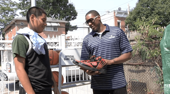 mario chalmers presents carlos mayorga with shoes Images + Videos: NBA Champion Mario Chalmers Awards New York Teen A New Hoop, Shoes & Game of One On One!