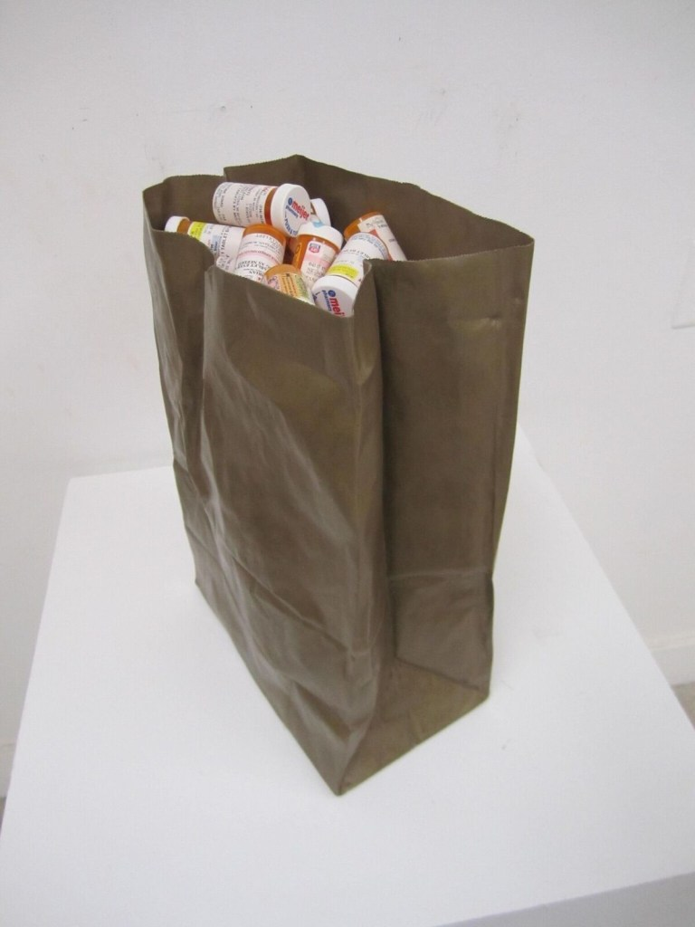 "Brian Nelson, ""This is my bag of quote (k)nots."" Cast and fabricated bronze paper bag, prescription medication bottles."