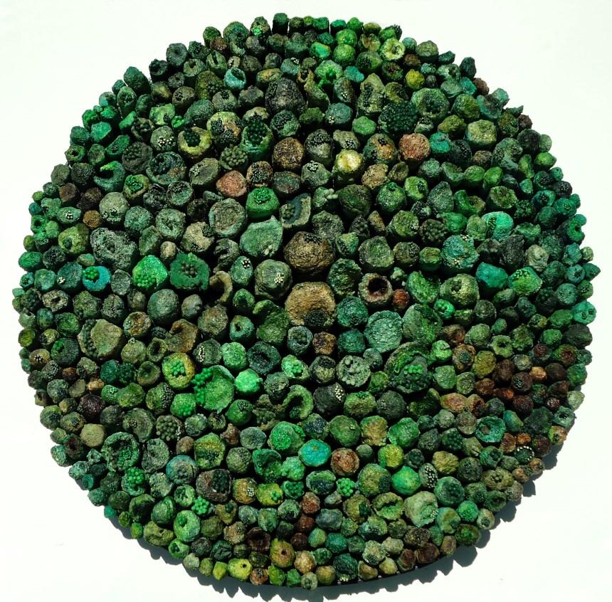 """Jonah Jacobs, """"Green Internode #1."""" Fire sculpted cardboard, paint, salt, dye, oatmeal, cotton swabs, fabric, sand, plaster."""