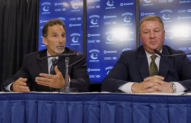 Canucks GM Mike Gillis and new coach John Tortorella