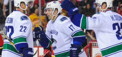 Vrbata, centre, celebrates after scoring his first goal of the season against the Calgary flames on  October 8, 2014 (photo courtesy of Derek Leung)