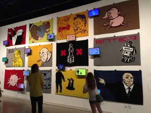 "A wall of Mothersbaugh-designed carpeting entrances visitors at the MOCA Cleveland presentation of ""Myopia."" PHOTO 