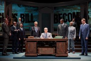 """Steve Vinovich, center, as President Lyndon Baines Johnson, and members of the ensemble of """"All the Way."""" 