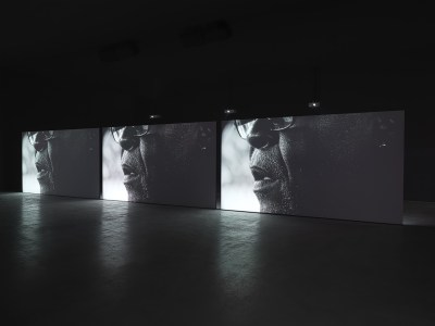 Adam Pendleton, My Education: A Portrait of David Hilliard, 2011-2014, 3-channel black-and-white video with sound, 9:19. Installation view, Becoming Imperceptible, Museum of Contemporary Art Denver, 2016. Courtesy of the artist and the Museum of Contemporary Art Denver.
