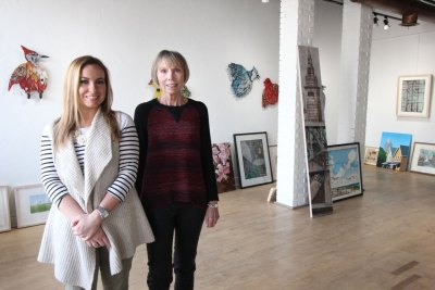 Gallery director Ellie Kaiser, left, and owner Meg Harris Stanton inside Harris Stanton Gallery's downtown Cleveland location as one show is set to come down off the walls and another waits to go up.