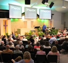 Congregation listening to Pastor Bruce preach