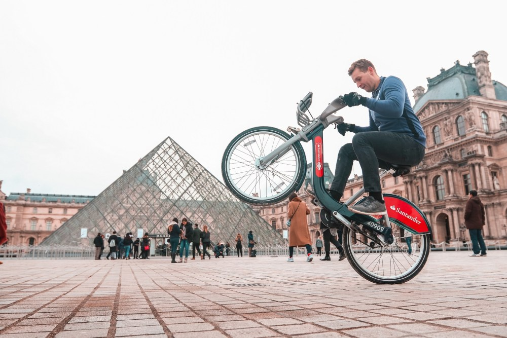 Chris Astil-Smith, 24 with his Boris bike in Paris, France. See National copy NNBIKE: A biking mad entrepreneur made a round the world cycling trip - on a Boris bike. Chris Astil-Smith, 24, rented the Boris bike and cycled around seven cities including New Delhi, Las Vegas and Paris. For three weeks in January Chris cycled around five countries and spent two days in each city capturing the trip with friend and videographer Alex Tyrwhitt. He faced security trouble in New York as well as Delhi where the entrepreneur was forced to bribe security £10 at the Taj Mahal to cycle inside.