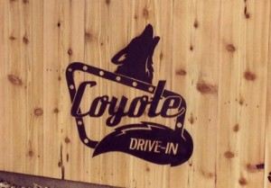 Coyote Drive-In logo on wood