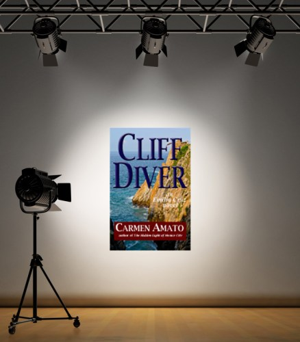 spotlight on a white background and CLIFF DIVER book by Carmen Amato