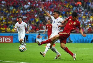 Diego Costa of Spain shoots against Gonzalo Jara of Chile during the 2014 FIFA World Cup Brazil Group B match between Spain and Chile.