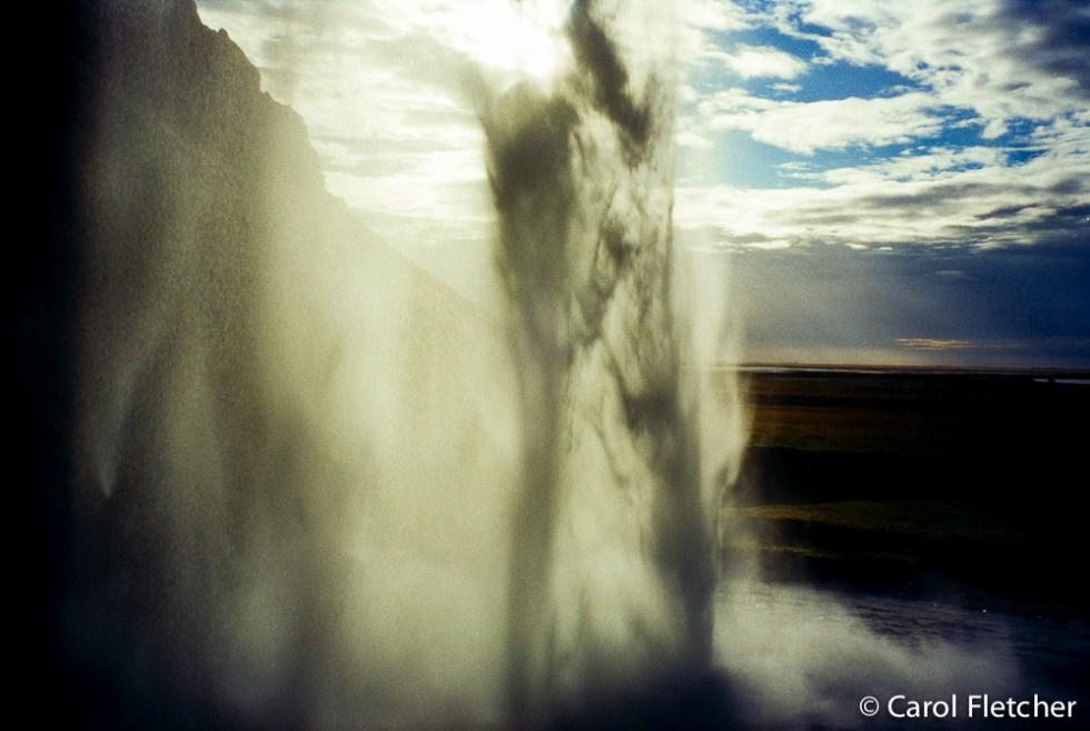 Seljalandfoss waterfall from behind