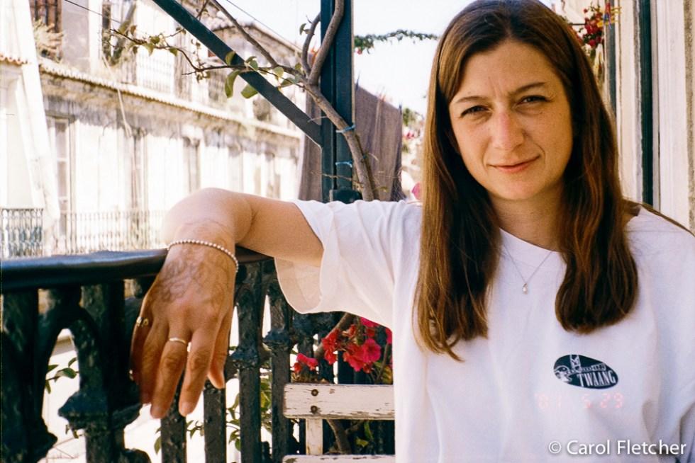 Carol on the Lisbon balcony with Marrakech henna'd hand