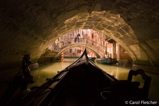 Bridges, canals, and bridges: View from a gondola in Venice
