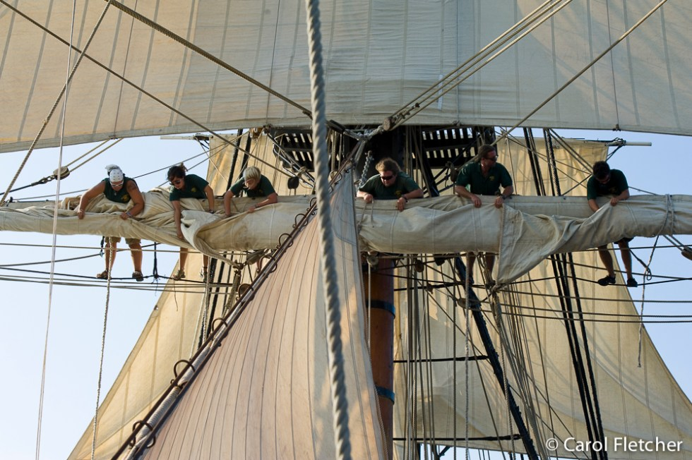 The Bounty crew furls the sails