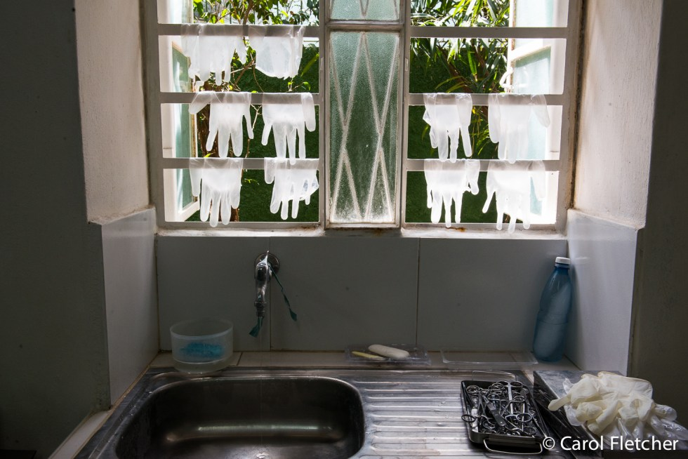 Disposable surgical gloves washed and drying in a window