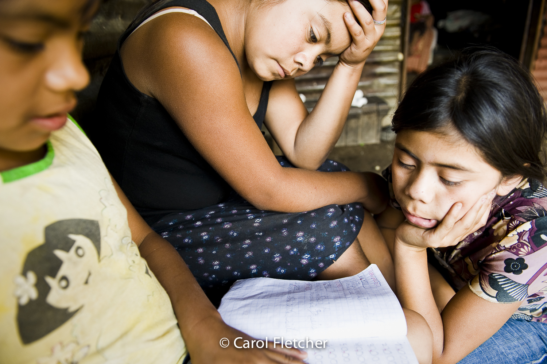 Guatemala girls study school books duenas