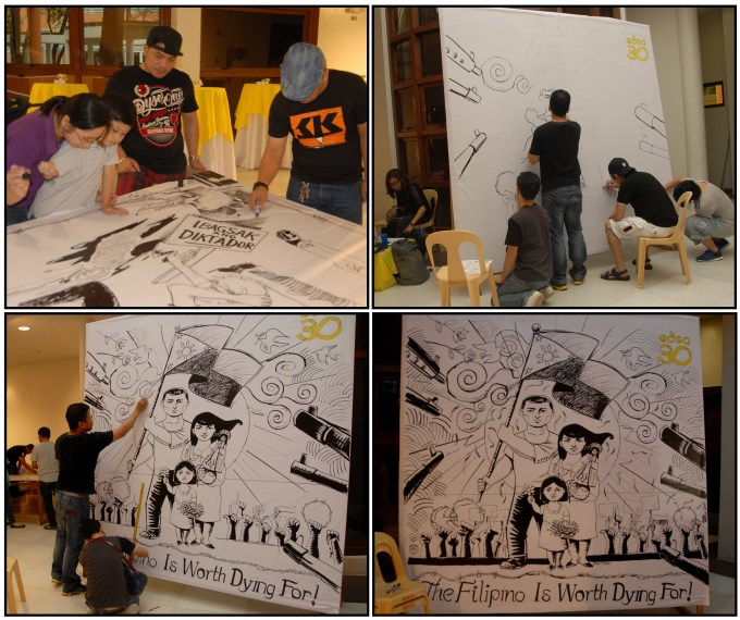 Members of the SKP cartoonists group produce a mural