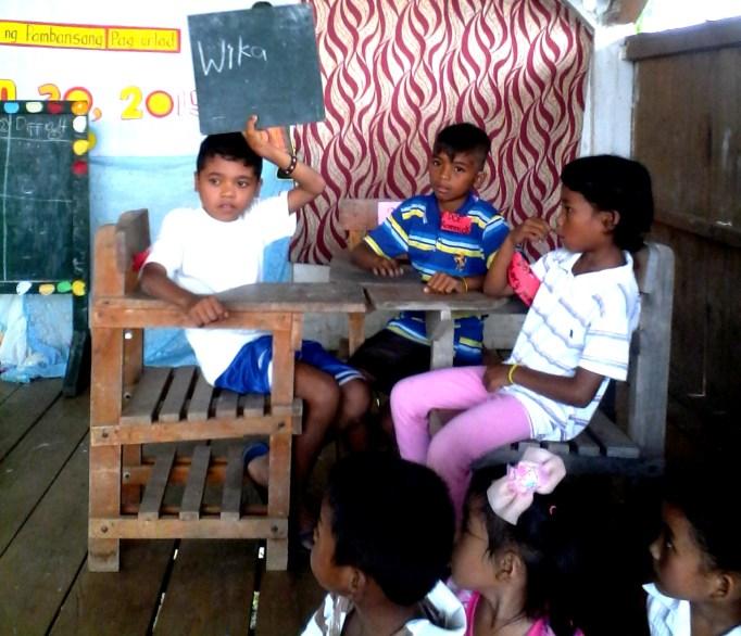 Higaonon representative learners participate in a Filipino Quiz Bee in a neighboring sitio