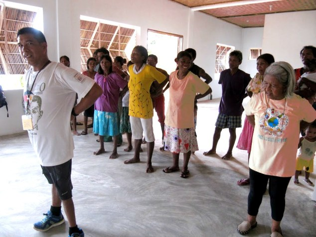 Community members from Sitio Alulad enjoy stress-reducing tapping exercises