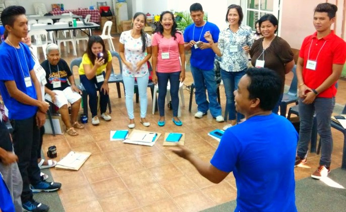 Charbee Gugma, Tagbanua from Culion, Palawan, leads the group in an interactive activity with song and movement.