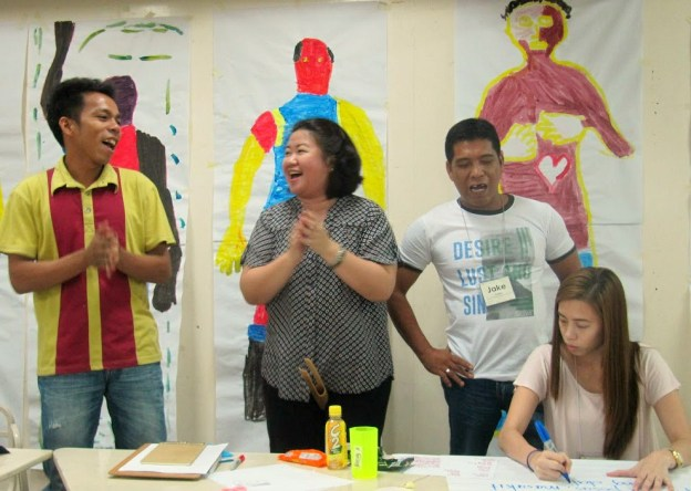 Noynoy (far left) practices a song his group creates as a positive way to culminate their session on anger
