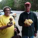 Joseph with a Porcini mushroom, Glen with a Cauliflower mushroom