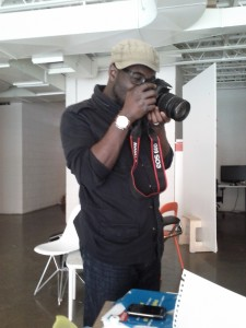 Casey Palmer with his Canon 60D, taking some pictures of the fruits of his labours