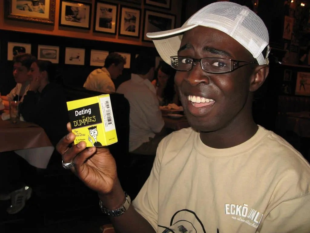Casey Palmer holding a Dating for Dummies toolkit that he'd received for his birthday.