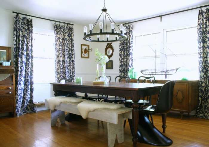 Eclectic Dining room in black, white, wood, navy, with green accents.
