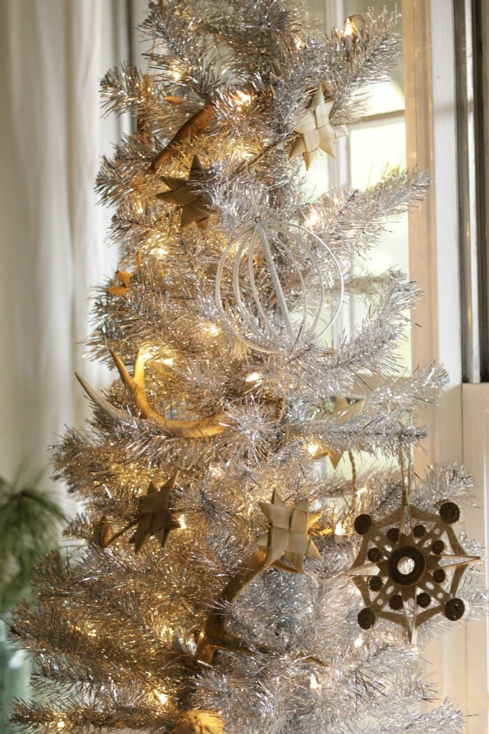Tinsel Tree in dining room with natural decorations
